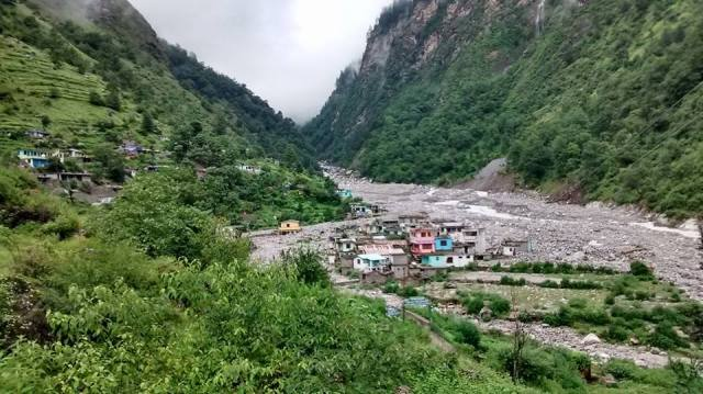 village in tracks to valley of flower