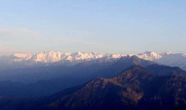 beautiful snowcap mountain from parashar lake